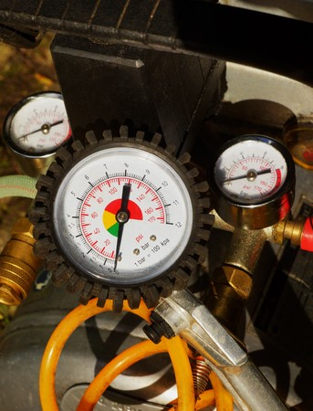 air pressure: Air pressure gauge in a car workshop
