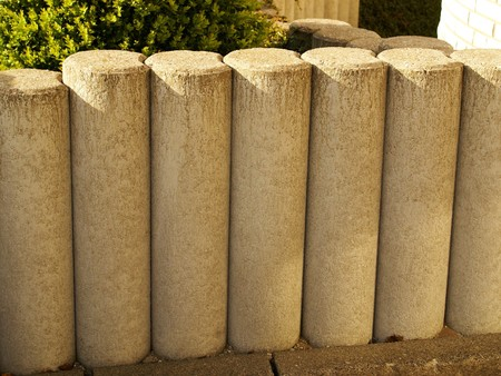entranceway: Picket fence of stone in front of a house Stock Photo