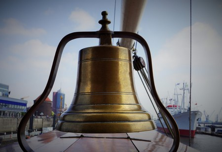 Old ships bell on a sailing ship