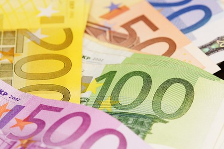 forgery: Several different euro banknotes on white background