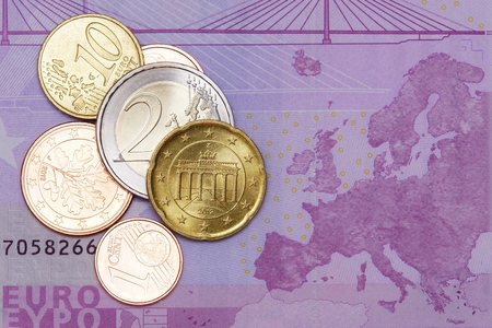 dinero falso: Several euro coins lying on euro banknotes Foto de archivo