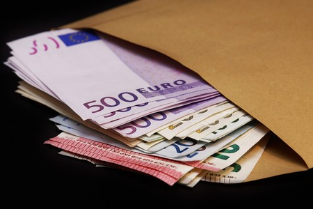 forgery: Euro banknotes in a large envelope