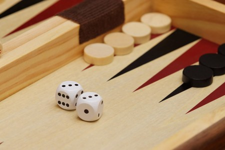backgammon: Cubes and game pieces on a backgammon board Stock Photo