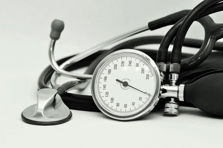midwifery: Blood pressure meter and stethoscope on white background Stock Photo