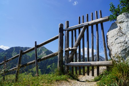 stakes: Wooden fence in the Alps under blue sky