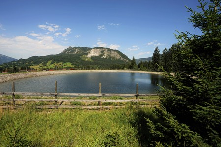 The Einstein mountain in the Allgaeu Alps, Tyrol Austria with storage pond