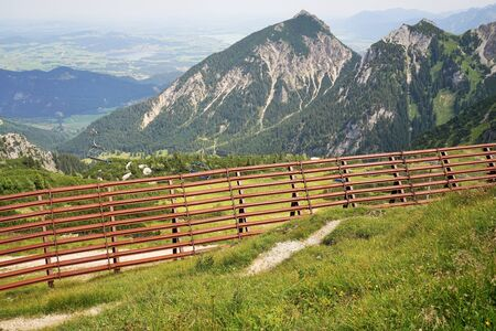 Avalanche fence in the Tyrolean Alps in summer
