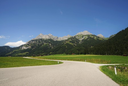 Road in the Tyrolean Alps in the direction of the mountain Red Flüh