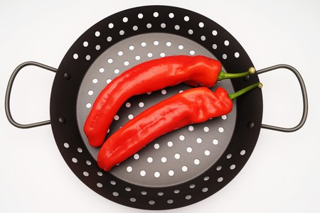Fresh red paprika on a grill pan Stock Photo