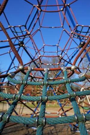 Climbing frame on a playground under blue sky