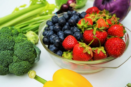 Organic fruits and vegetables on a white background Stock Photo
