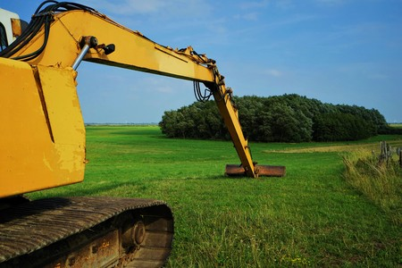 Large excavator on the dike in Schleswig Holstein