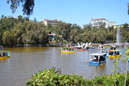Family Boating at Burnham Park Lake located in the heart of Baguio City. Baguio City is the Summer Capital of the Philippines located in Northern Luzon, Benguet.