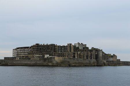 Hashima-eiland (Gunkanjima; betekenis slagschipeiland) in Nagasaki, Japan Stockfoto
