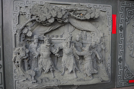 Decorative stone carving on the wall at Sun Moon Lake Wen Wu Temple in Taiwan 에디토리얼