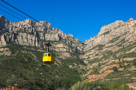 Yellow cable car at Montserrat in Catalonia, Spain