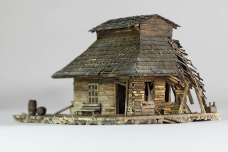 Western ghost town railway station made of matchsticks, side and front view, broken windows