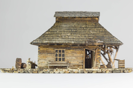 Western ghost town railway station made of matchsticks, front view, low angle camera
