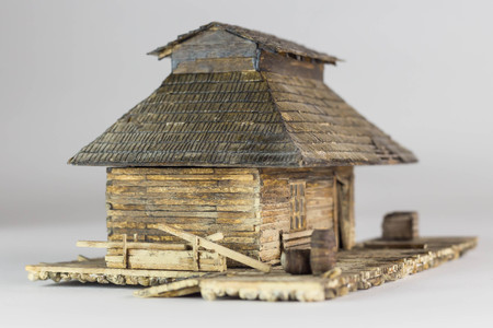 Western ghost town railway station made of matchsticks, side and front view