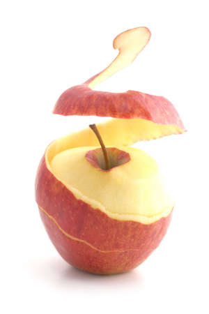 red peeled apple. peel levitates showing pulp Stock Photo