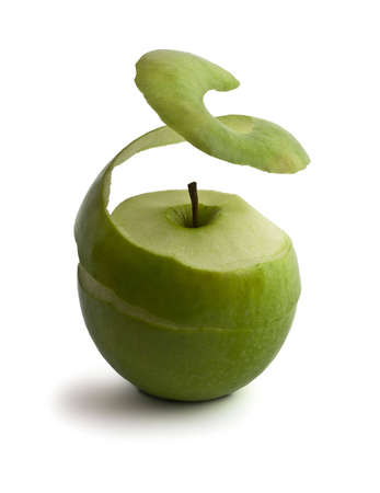 peeled: green peeled apple. peel levitates showing pulp Stock Photo