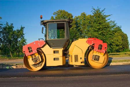 renewing: Road renewing; Steamroller over a fresh asphalt layer