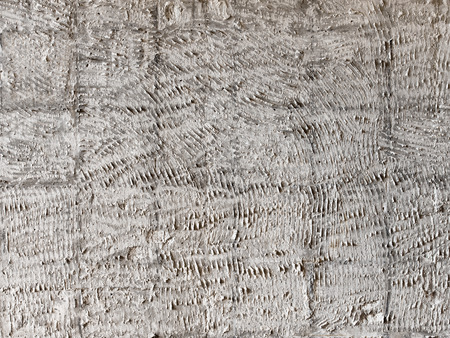 combed: Rough wall texture taken after old tiles removing. Irregular pattern.