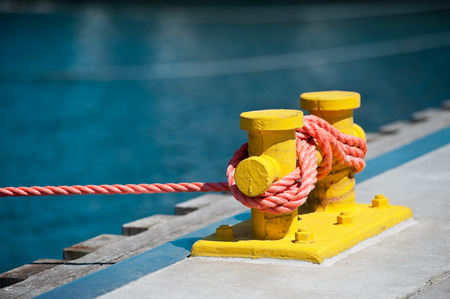 yellow on line: The quay. A mooring line attached to a bitt.