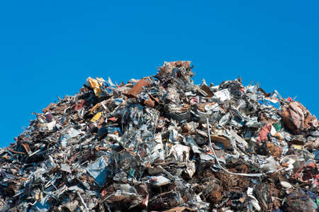 scrap: Pile of scrap metal over blue sky. Stock Photo