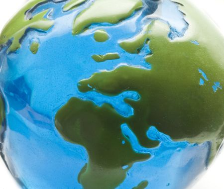 blue and green globe on white background