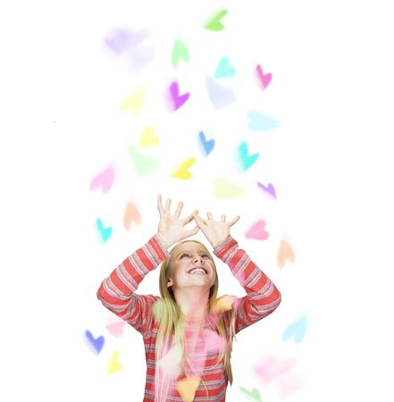 paper hearts are falling down on girl Stock Photo