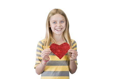 smiling girl with a homemade glitter heart Stock Photo - 4947471