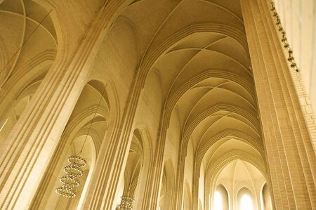 ceiling and pillar in a church made of yellow bricks