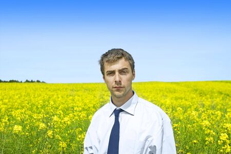 businessman in a yellow flower feild