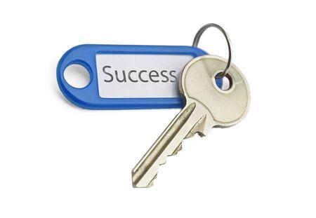 the blue keyring key to success on white background Stock Photo