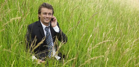young businessman is out of office in a field