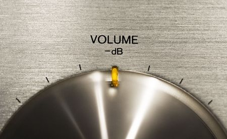 close up of a volume push button on a hi-fi