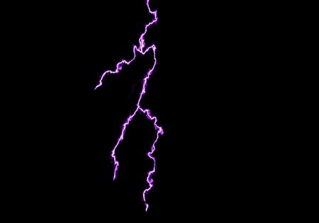electrifying: blue lightning extends  across a black background