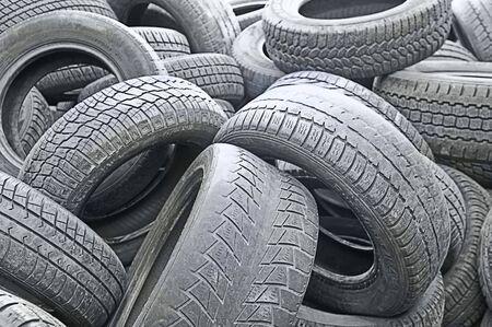 a stack of old run-down tires on a auto repair shop Stock Photo - 5346025
