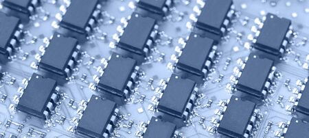 Close up of computer chip and electrical component Stock Photo