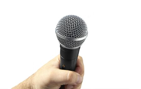 hand is holding a Microphone on a white background