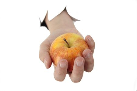female hand is holding a apple on a white background Stock Photo