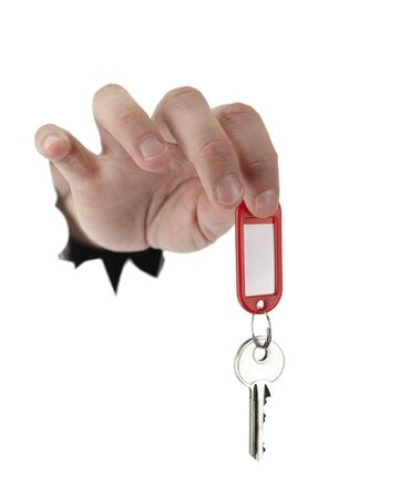 female hand is giving house key on a white background photo