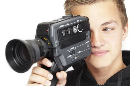 A young photographer with a 8mm camera photo