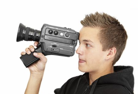 A young photographer with a 8mm camera