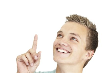 a smiling young teenager is pointing up.