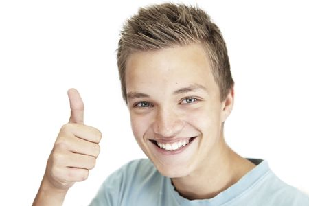 young man giving a  thumbs up. Stock Photo - 5652971