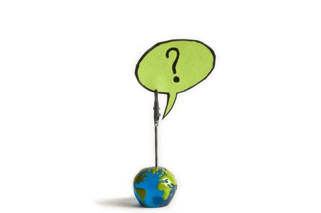 questioned: what now ? question mark from a globe