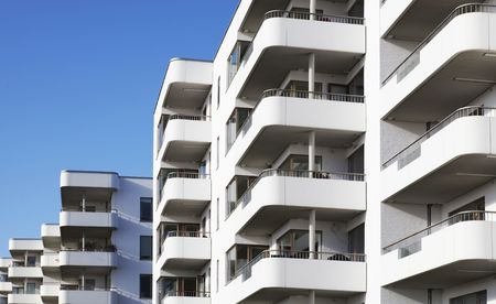 multifamily: a balcony front on a Building Exterior Stock Photo