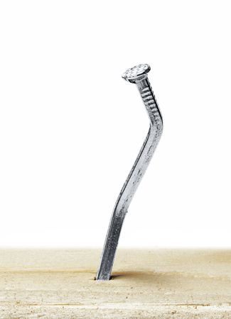 bent: a nail is bent out of shape on a white background  Stock Photo